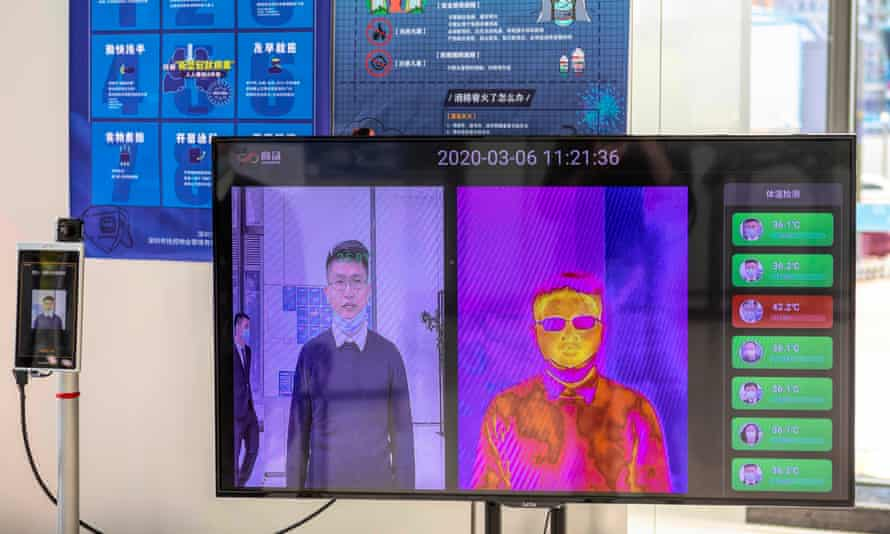 A 'Smart AI Epidemic Prevention' made by the company SenseTime, in Shenzhen, can detect if people have a fever and identify faces even behind a mask.