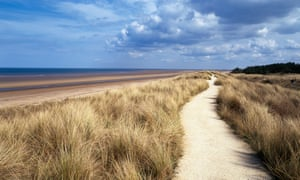 Path through marram grass by sea on sunny day at Holme next the Sea