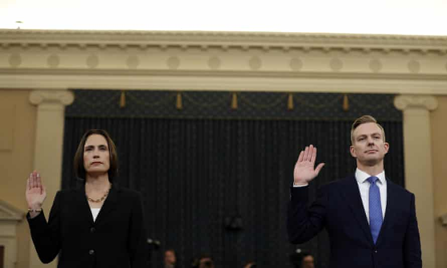 Fiona Hill and David Holmes are sworn in to testify before the House intelligence committee in Washington DC, on 21 November.