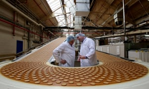 Management workers on a biscuit production line at the McVitie's food factory, Stockport, UK