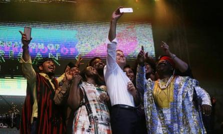 Emmanuel Macron takes a selfie