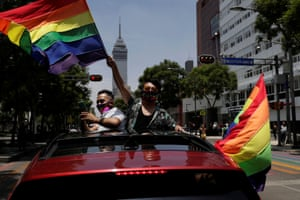 A participant flutters a rainbow flag near the Bellas Artes Palace to celebrate gay pride in Mexico City