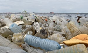 Plastic bottles and other waste cover a beach after being washed ashore near the port of Abidjan, Ivory Coast.