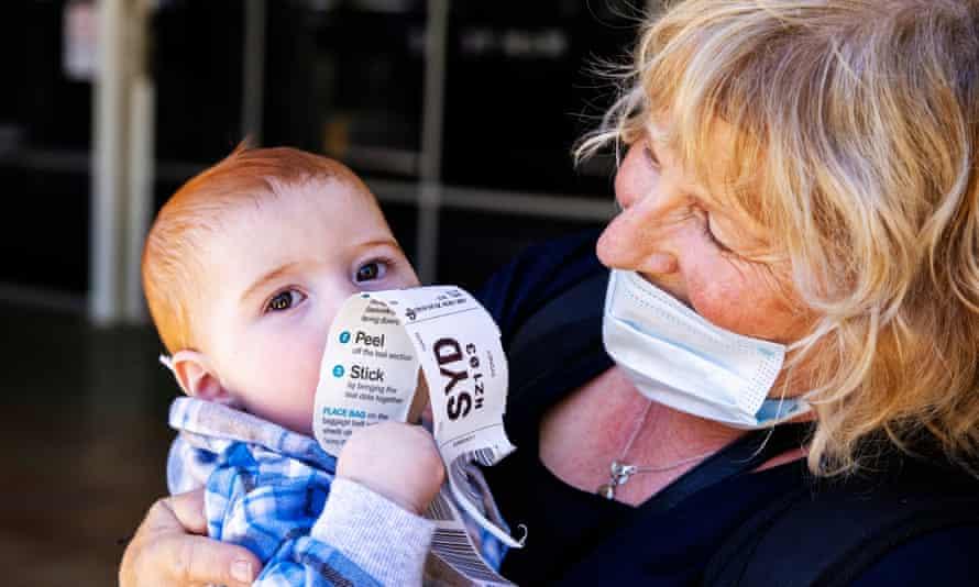 Dianne Wright kisses her grandson Mason Buckley at Sydney International Airport