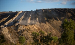 A large bulldozer works to move tailings pulled out of the Clermont coalmine in Queensland.