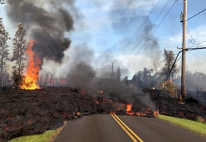 Lava from a fissure slowly advances to the northeast on Hookapu Street after the eruption of Hawaii's Kilauea volcano.