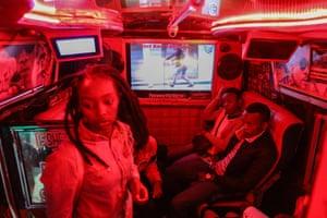 A TV plays inside a matatu