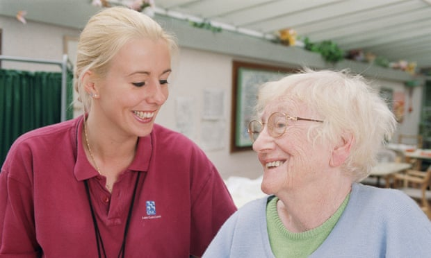 Female occupational therapist and elderly woman smiling during session to improve balance and stability in hospital