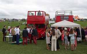 Epsom, UK Racegoers enjoy the atmosphere before Ladies' Day at the Investec 2019 Derby festival