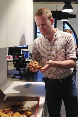 Adam Brereton, opinion editor at Guardian Australia, tries meat-pie pizza. This photo aside, afterwards he did say he liked it.