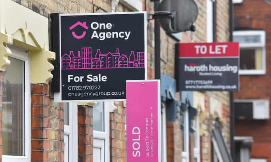 Placards from estates agents on properties in Stoke-on-Trent