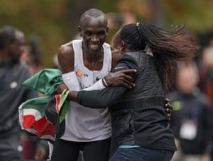 Eliud Kipchoge is hugged by his wife Grace Sugutt after breaking the historic two-hour marathon barrier in Vienna.