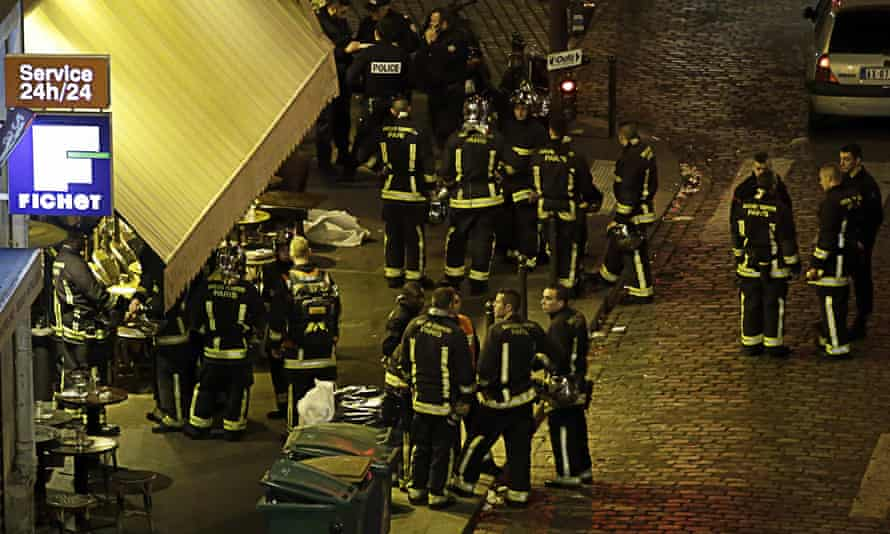 Police and rescuers outside a cafe in the 10th arrondissement of Paris on 13 November 2015, the night of the attacks.