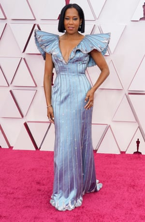 There's something deeply transformative about Regina King's custom-made blue silk dress by Louis Vuitton. Maybe it's the ethereal blue shade. Maybe it's the structure. It's probably the butterfly wings attached to the shoulders.