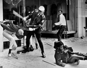 A police officer uses his nightstick on a youth reportedly involved in the looting that followed the breakup of a march led by Dr. Martin Luther King Jr. March 28, 1968, in Memphis, Tenn. (AP Photo/Jack Thornell)