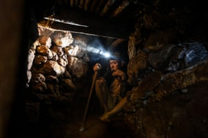 A miner takes a break while working in a tunnel in a ruby mine in Mogok, north of Mandalay
