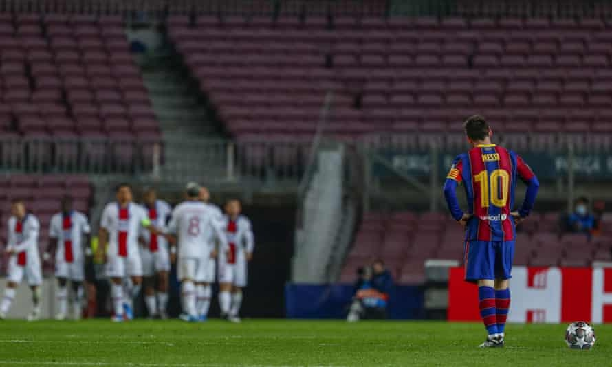 Lionel Messi watches PSG players celebrate a goal at Camp Nou.