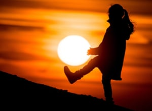 <strong>Sieversdorf, Germany</strong><br>A young girl is silhouetted by the sun. There will be no total eclipse of the sun in Germany but skies will darken a bit