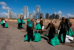Israelis who lost their jobs because of Covid collect rubbish on the beach at the Peleg nature reserve in Netanya in October.