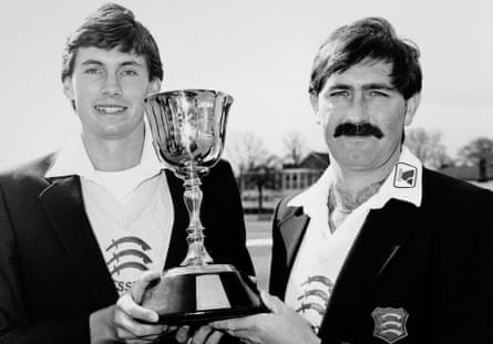 Graham Gooch and Neil Foster hold the County Championship trophy in 1984.