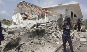 Security forces guard the scene of the bombing in Mogadishu