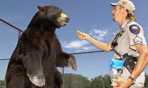 Joe Exotic, from Tiger King, with Boo, a North American black bear