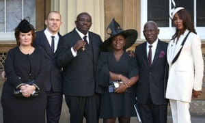 Edward Enninful receiving his OBE at Buckingham Palace in October 2016. From left: his partner's mother, Enid Maxwell; his partner, Alec Maxwell; Edward Enninful; his sister, Akuna Enninful; his father, Major Crosby Enninful; and model Naomi Campbell
