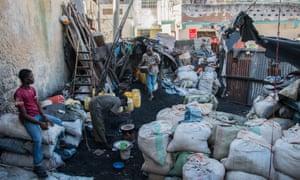 Charcoal vendors prepare dinner in Mombasa, Kenya