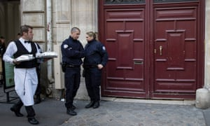 French police stand guard outside one of the entrances to the Hôtel de Pourtalès