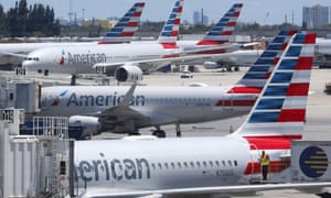 American Airlines aircraft are shown parked at their gates at Miami international airport in Miami, one of 17 airport where protests are planned to take place.