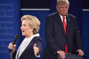 Trump listens to Democratic candidate Hillary Clinton during the second presidential debate at Washington University in St Louis