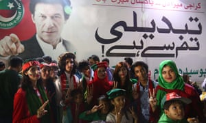 Supporters of Imran Khan celebrate in Karachi.