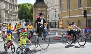 A man on a penny farthing