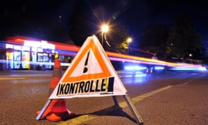 A sign reading 'control' stands on the road at the German-Austrian border near Lindau in southern Germany.