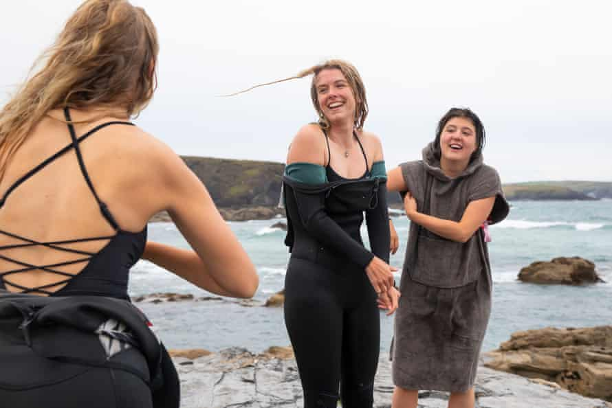 The three women beside the water's edge