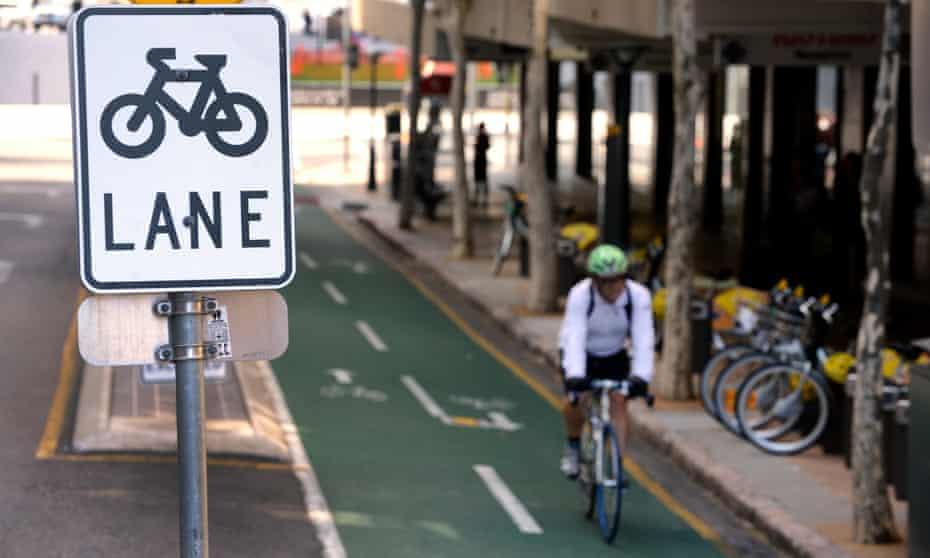 A cyclist rides his bike on a bike lane in Brisbane