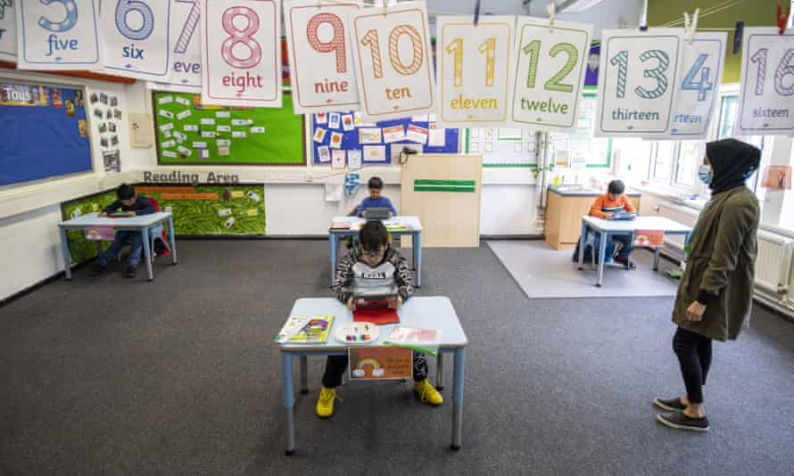 Children maintain social distancing at Earlham primary in London