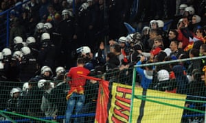 Police scuffle with Montenegro supporters during the Euro 2016 qualifying football match against Russia in Podgorica in March 2015.