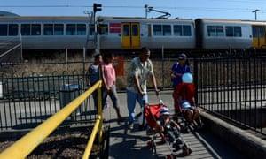 Passengers disembark from a Queensland train