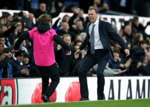 Ferguson celebrates with the other ball boy.
