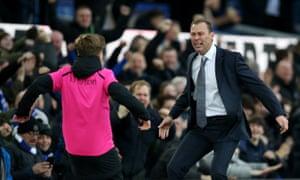 Duncan Ferguson celebrates Everton's third goal with a ball boy.