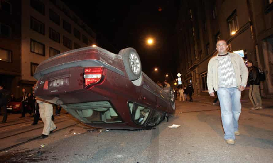 A car is left overturned by the violence in Tallinn in April 2007.