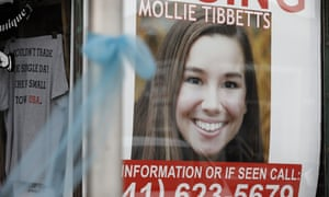 A poster for the missing University of Iowa student Mollie Tibbetts hangs in the window of a local business in Brooklyn, Iowa, on Tuesday. Cristhian Bahena Rivera, 24, has been charged with her murder.