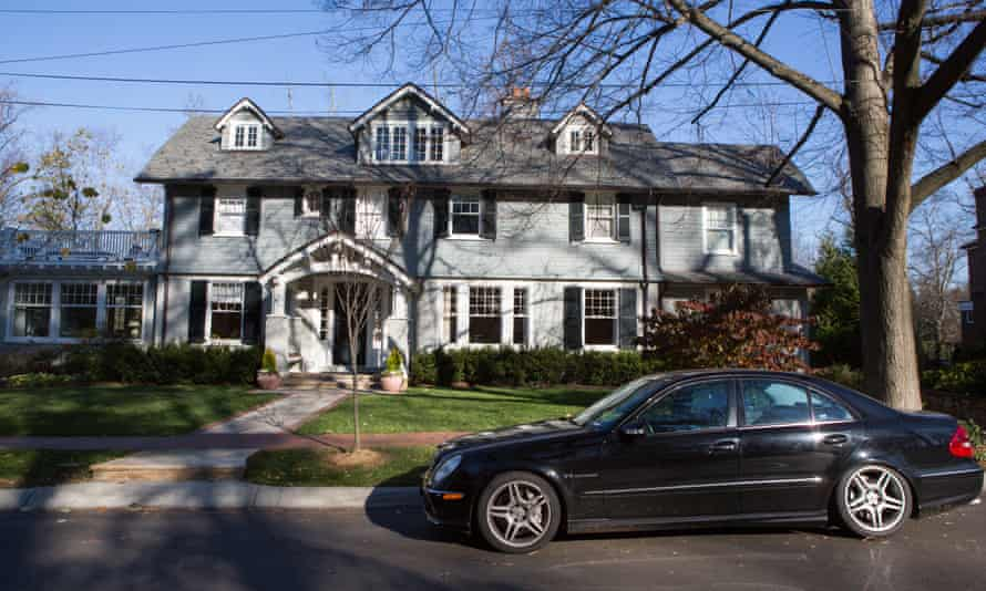 A luxury vehicle is parked outside of a house on W. Lenox Street in Chevy Chase Village, Maryland.