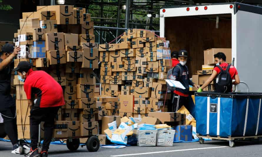 Amazon drivers stack packages for delivery on Manhattan's west side in New York.