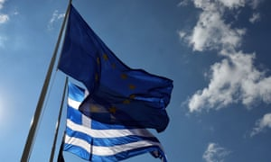 The flags of Greece and the EU fly in Athens