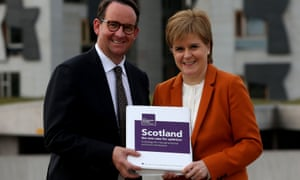 Nicola Sturgeon receiving a copy of the sustainable growth commission report from its chair, Andrew Wilson.