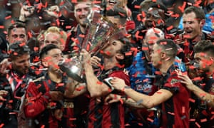Michael Parkhurst celebrates with his teammates after Atlanta's victory