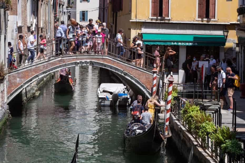 Tourists gather in Venice, Italy. Many Italian businesses have been allowed to reopen after more than two months of a nationwide lockdown.
