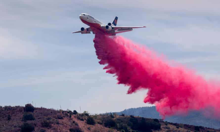 An air tanker drops slurry on the Telegraph fire, on 7 June 2021, at Cherry Flats, south of Miami, Arizona.